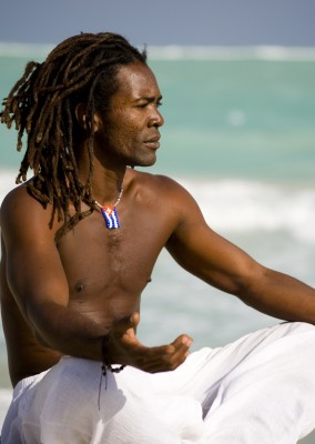 African American Male meditating ocean
